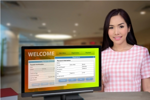 Receptionist with digital screen to welcome and sign in guests