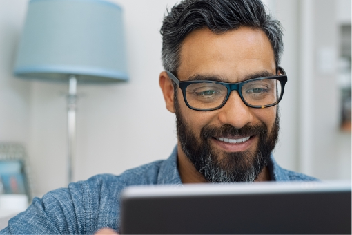 Man smiling in an online meeting