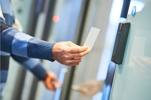Man using a touch free door entry system