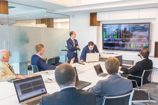 Colleagues using audio visual equipment in modern meeting room
