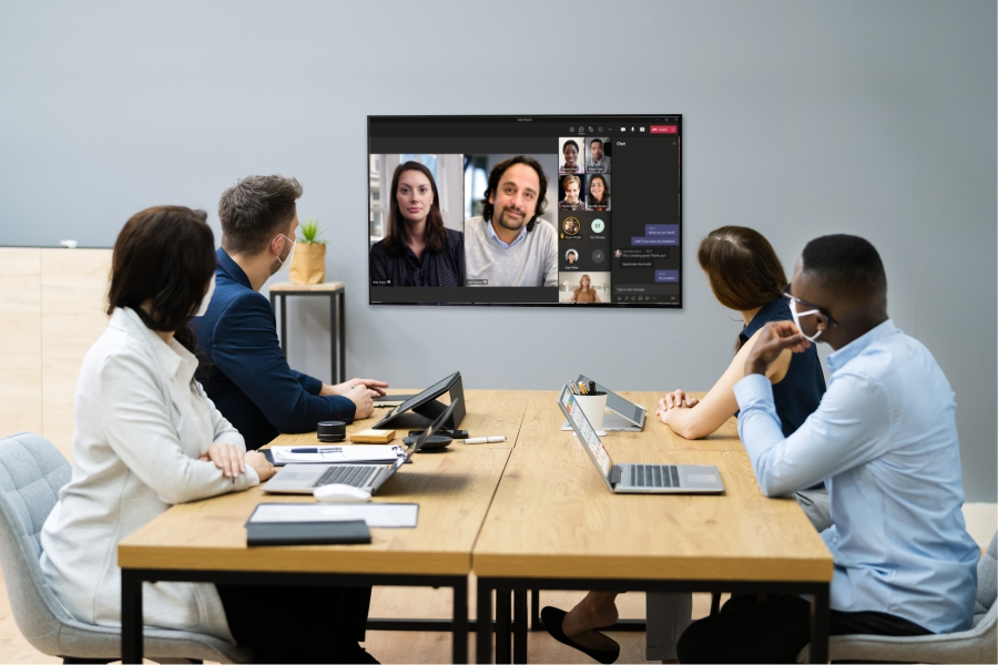 Colleagues video conferencing using Microsoft Teams room solution